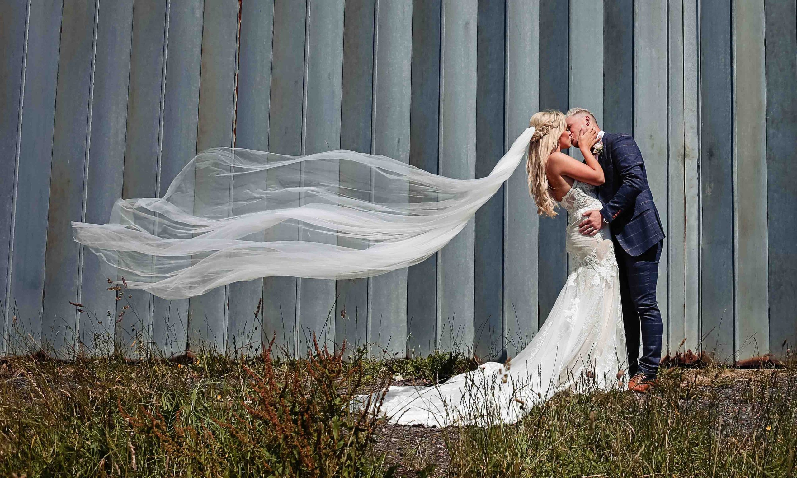 Wedding couple with train flowing free.